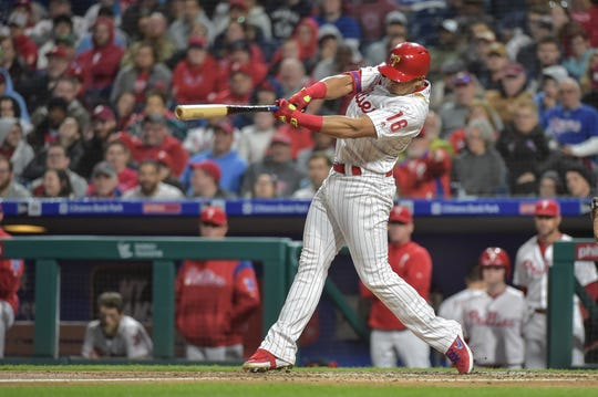 Apr 10, 2019; Philadelphia, PA, USA; Philadelphia Phillies second baseman Cesar Hernandez (16) hits a single during the second inning of the game against the Washington Nationals at Citizens Bank Park.