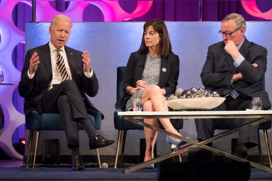 """Former Vice President Joe Biden, left, speaks as Professor of Emergency Medicine at the Perelman School of Medicine Jeanmarie Perrone, center and Philadelphia Mayor James Kenney listen during the 2019 David & Lyn Silfen University Forum: """"Is There an Antidote for the Opioid Epidemic? Seeking a Cure for the Worst Drug Crisis in American History Thursday at the Irvine Auditorium at the University of Pennsylvania."""