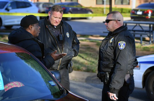 Wichita Falls Police gather information following an officer-involved shooting of an armed suspect near the intersection of Martin Luther King Jr. Blvd and Third Street Thursday morning. A white male was shot and taken to the hospital by ambulance.