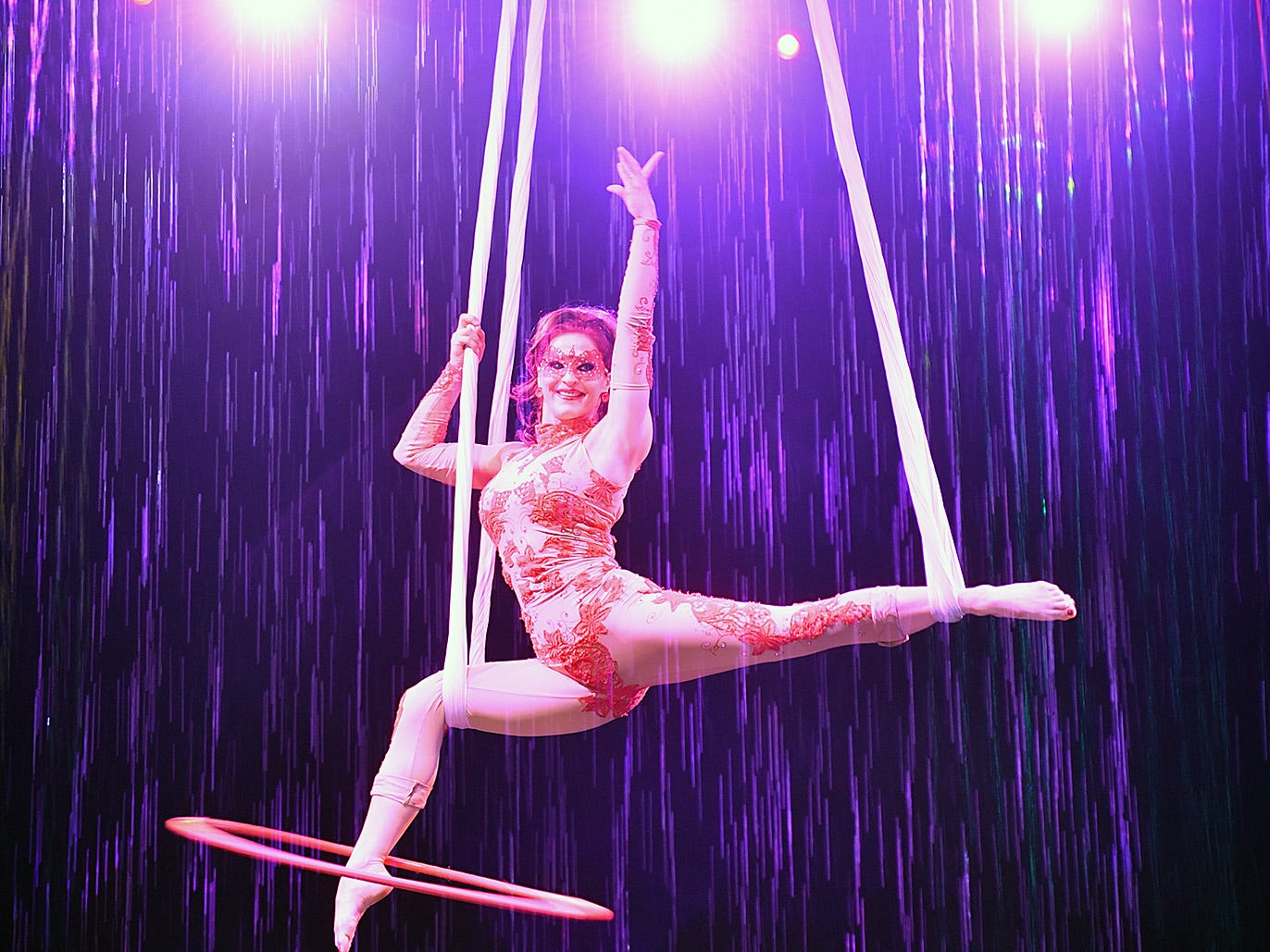 Many of the acts in Cirque Italia feature performers high above the stage surrounded by streams of fountains.