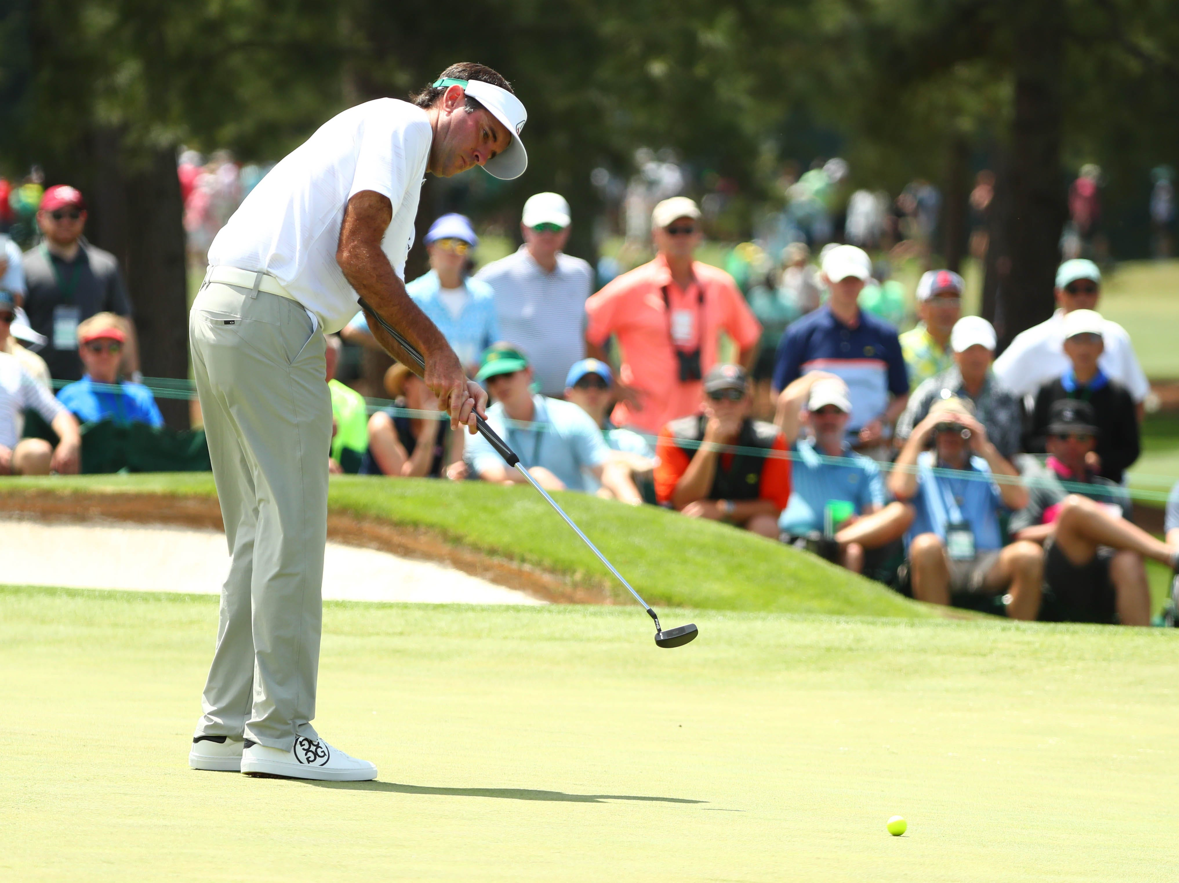 Bubba Watson putts on the second green during the first round of the Masters.