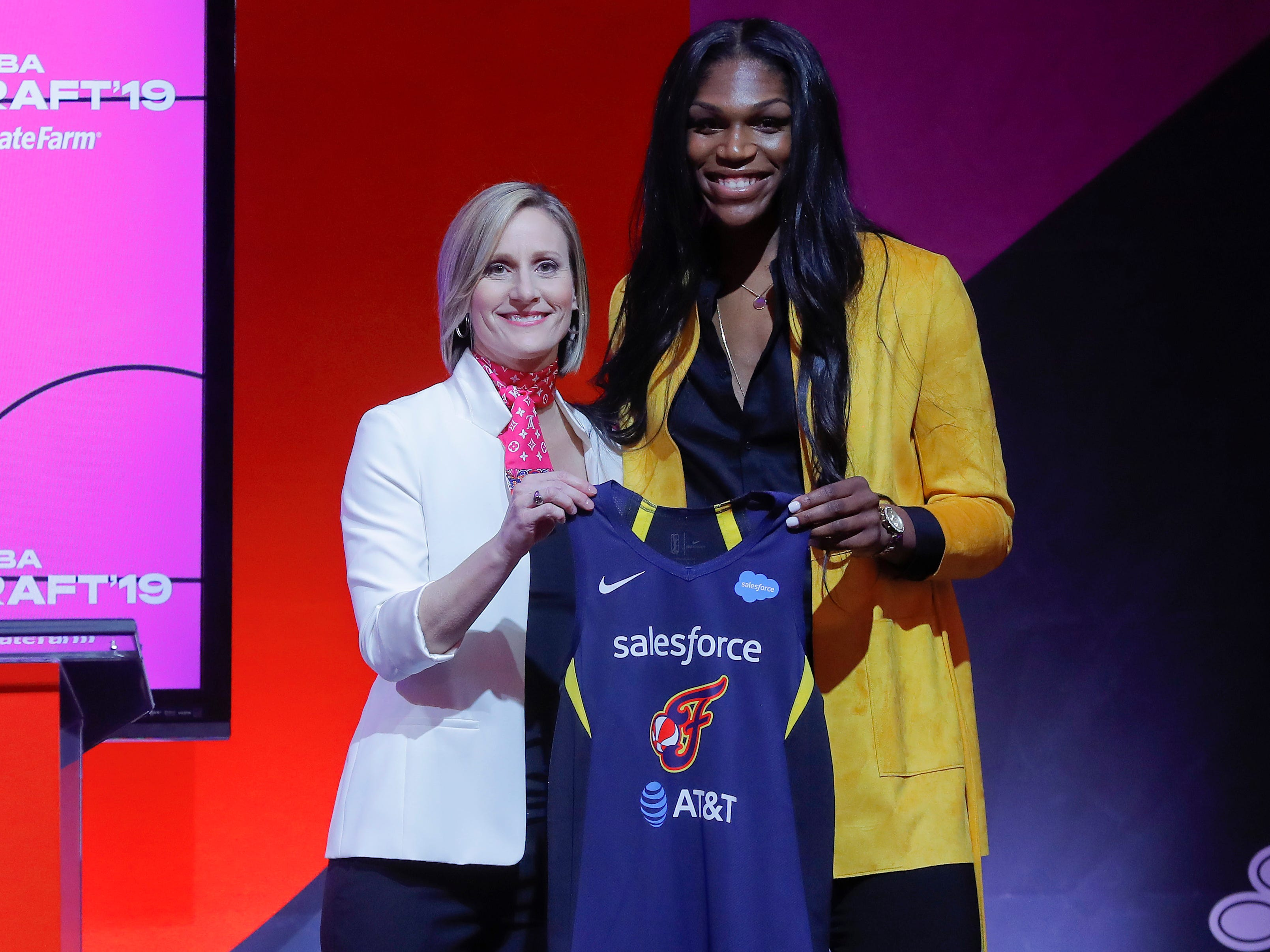 Mississippi State's Teaira McCowan poses for a photo with WNBA COO Christy Hedgpeth after being selected by the Indiana Fever as the third overall pick in the WNBA draft.