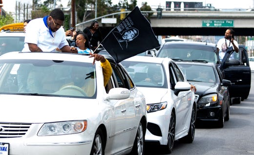 A funeral procession for Nipsey Hussle moves through Los Angeles following a memorial service at the Staples Center.