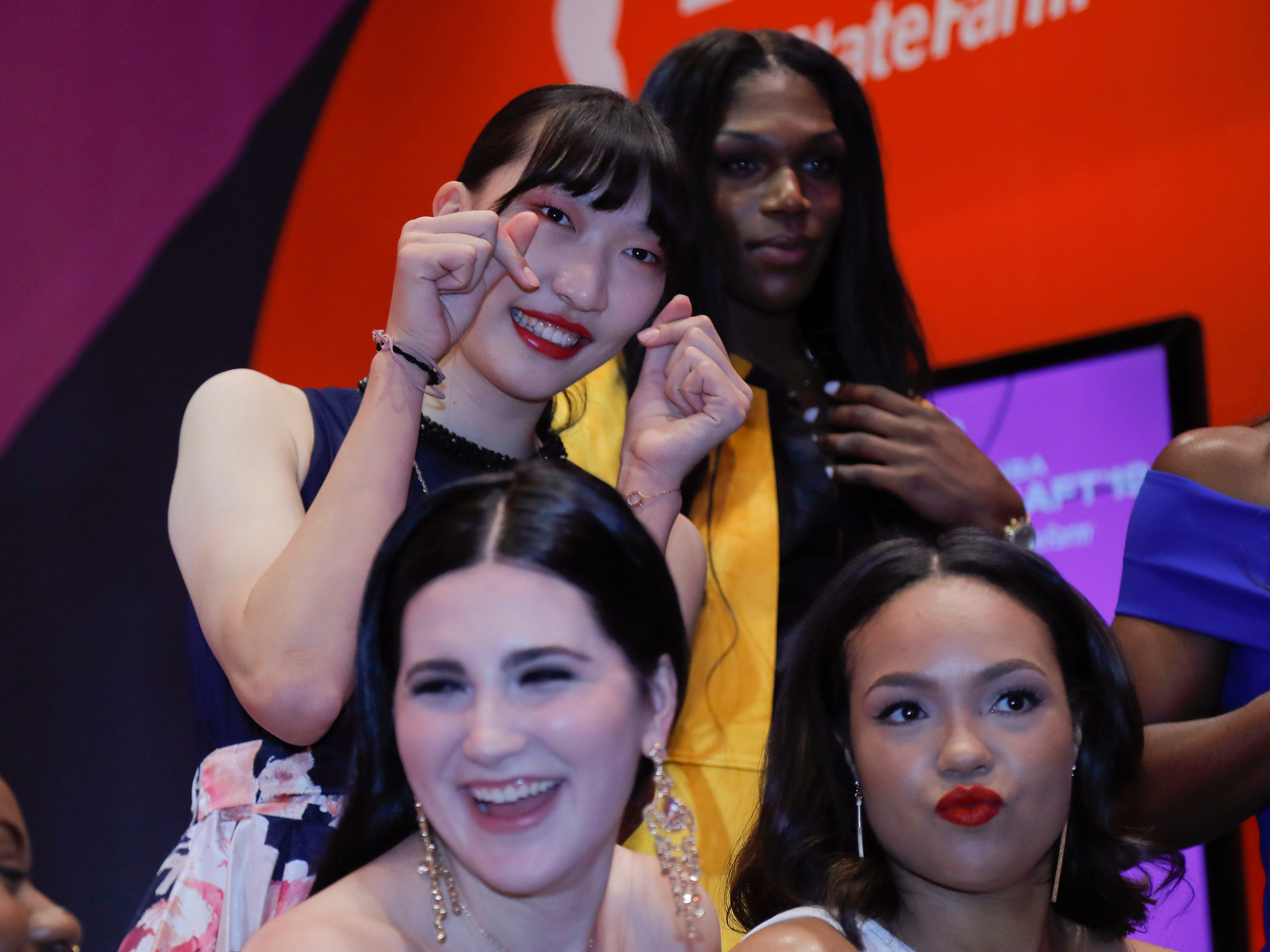 Han Xu, Teaira McCowan, Napheesa Collier and Megan Gustafson pose for photos before the WNBA draft.