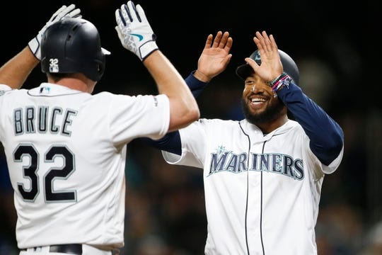 Jay Bruce and Domingo Santana celebrate a home run.