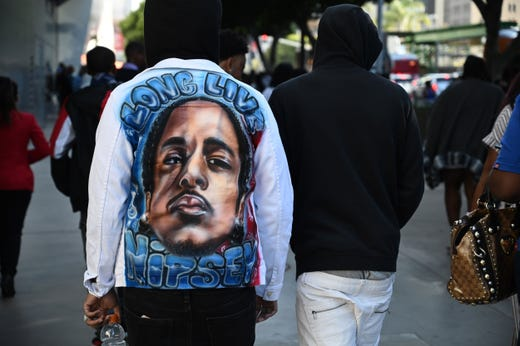 People arrive to attend the Celebration of Life memorial service for rapper recording artist and social activist Nipsey Hussle, April 11, 2019 at the Staples Center in Los Angeles.