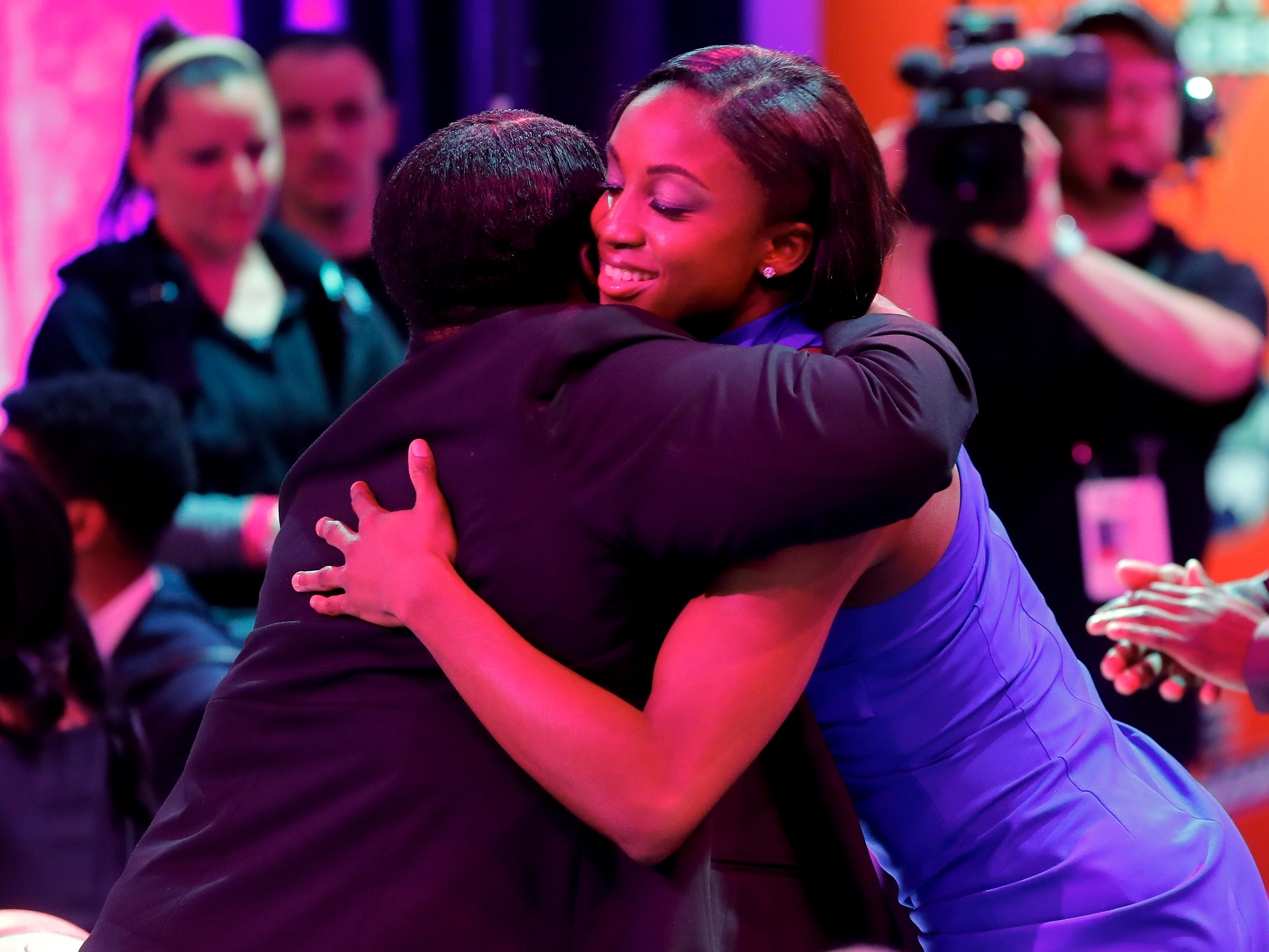 Notre Dame's Jackie Young hugs a relative after being selected by the Las Vegas Aces as the No. 1 pick in the WNBA draft.