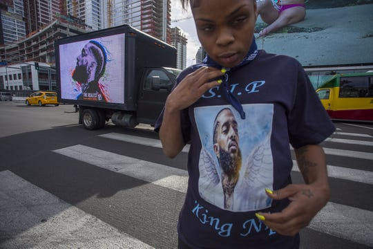 People gather outside a memorial celebration for slain rapper Nipsey Hussle at the Staples Center arena.