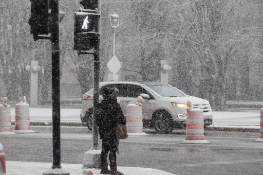 A spring snow shower arrived as commuters were making their way home from work on Wednesday, April 10, 2019 in downtown Milwaukee.