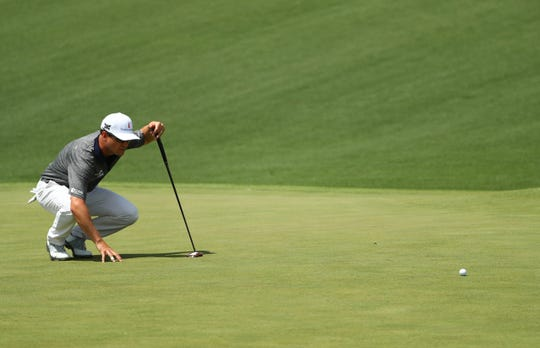 Zach Johnson lines up a during the first round of the Masters at Augusta National Golf Club.