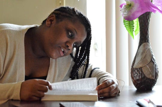 C'alra Bradley reads verses from the Bible that have given her strength.