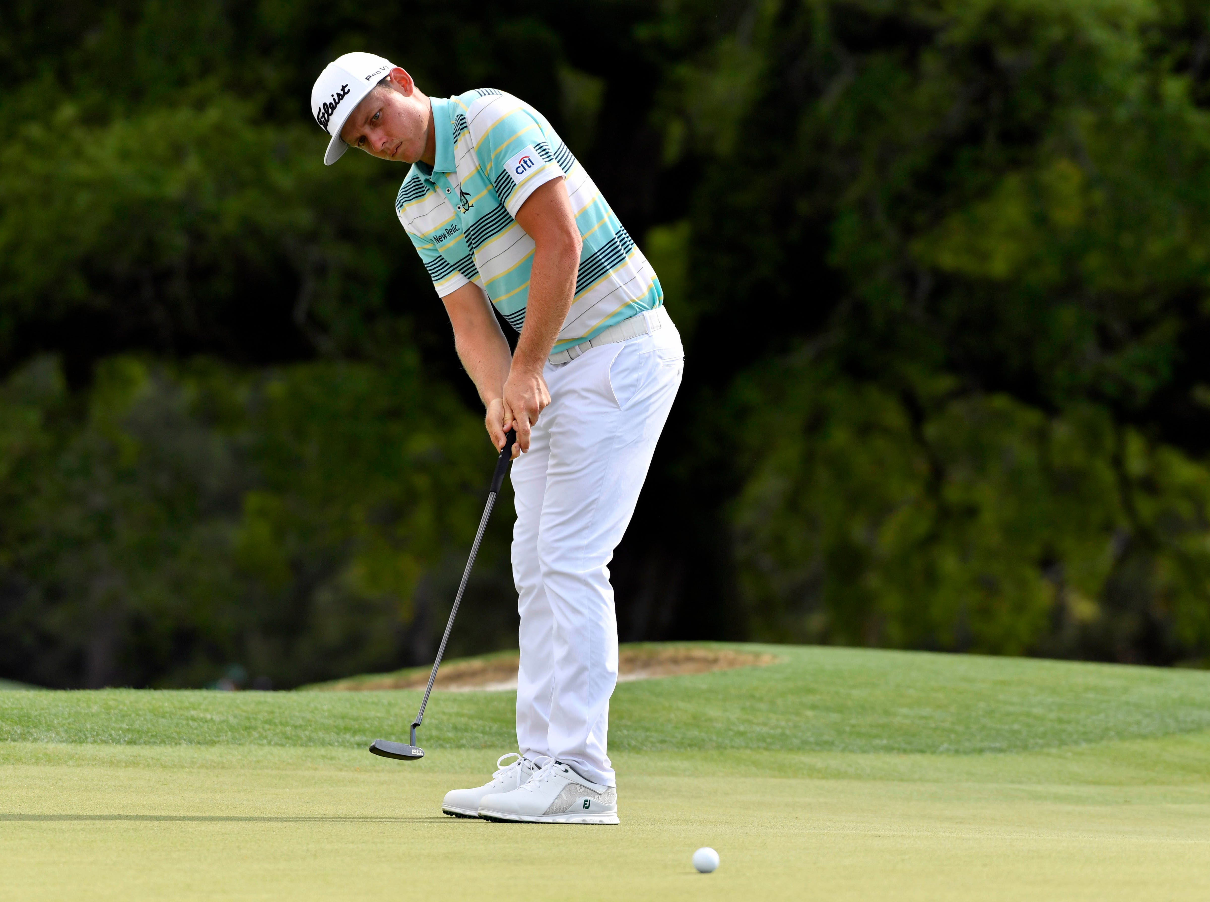 Cameron Smith putts on the 18th green during the first round of the Masters.