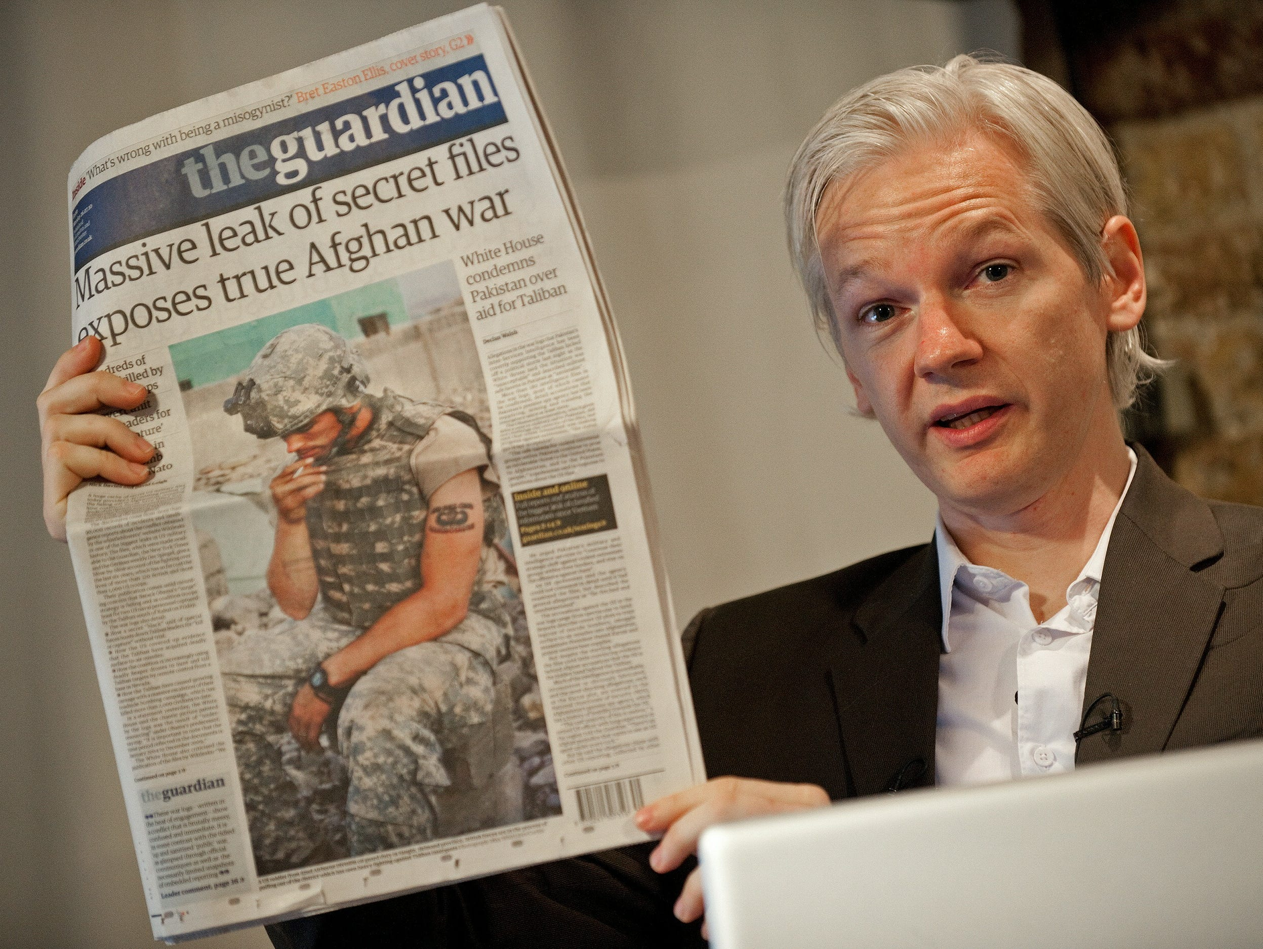 Julian Assange, holds up a copy of today's Guardian newspaper during a press conference in London on July 26, 2010. Assange first rose to prominence after Wikileaks published of thousands of leaked military files about the war in Afghanistan  In all, some 92,000 documents dating back to 2004 were released by the New York Times, Britain's Guardian newspaper, and Germany's Der Spiegel news weekly.