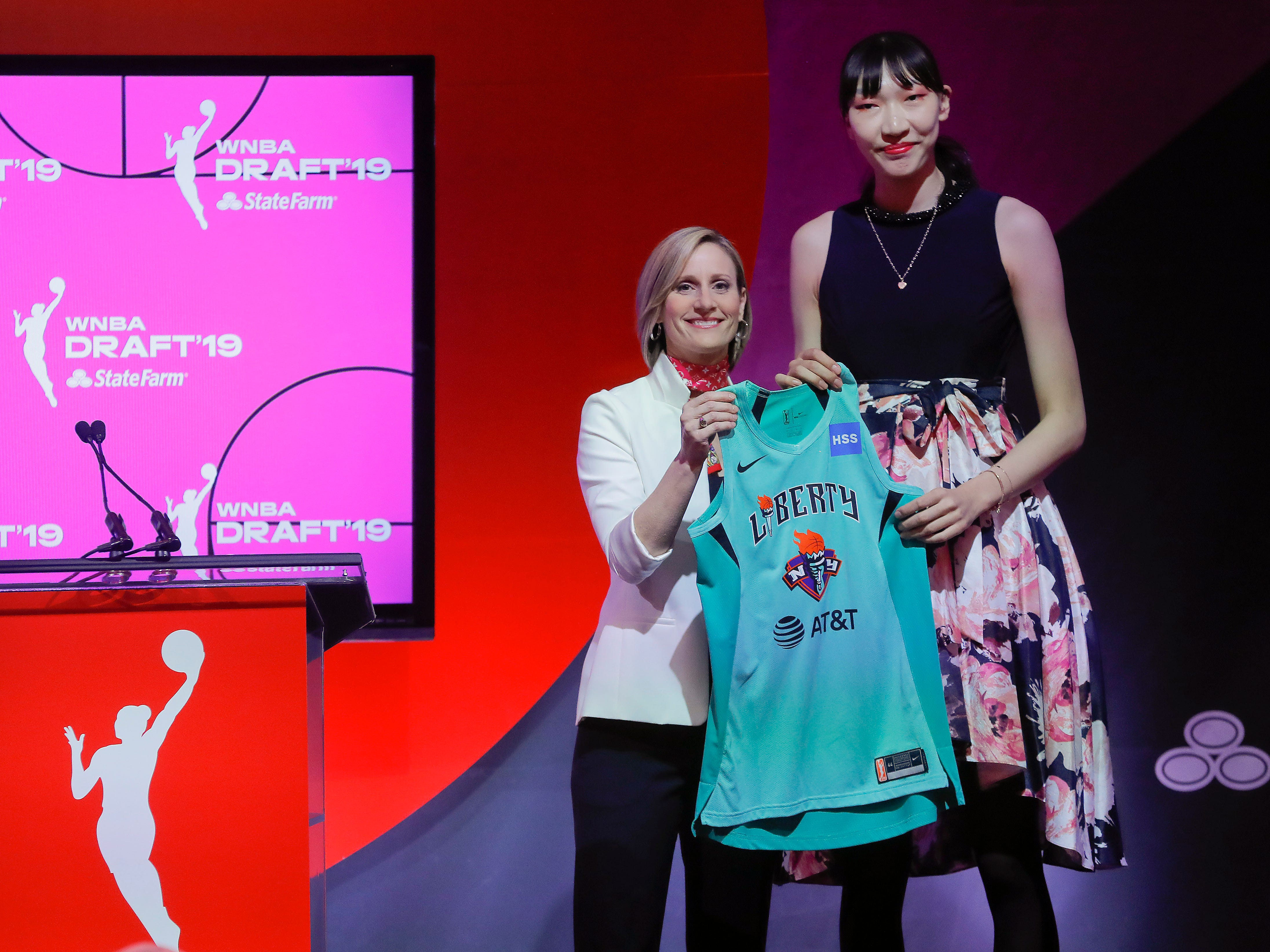 Han Xu, of China, poses for a photo with WNBA COO Christy Hedgpeth after being selected by the New York Liberty in the second round of the WNBA draft.