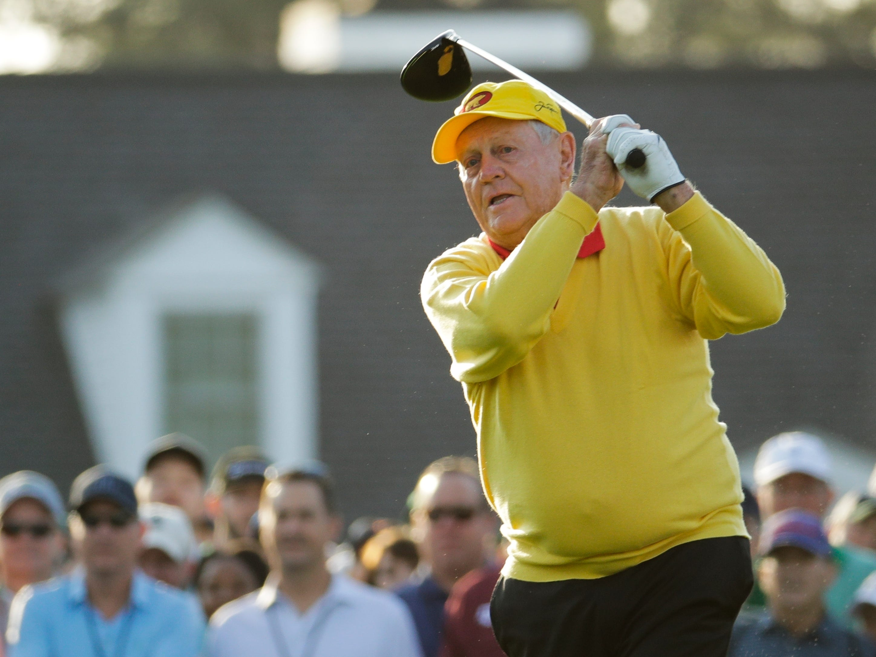 Jack Nicklaus hits a ceremonial tee shot on the first hole.