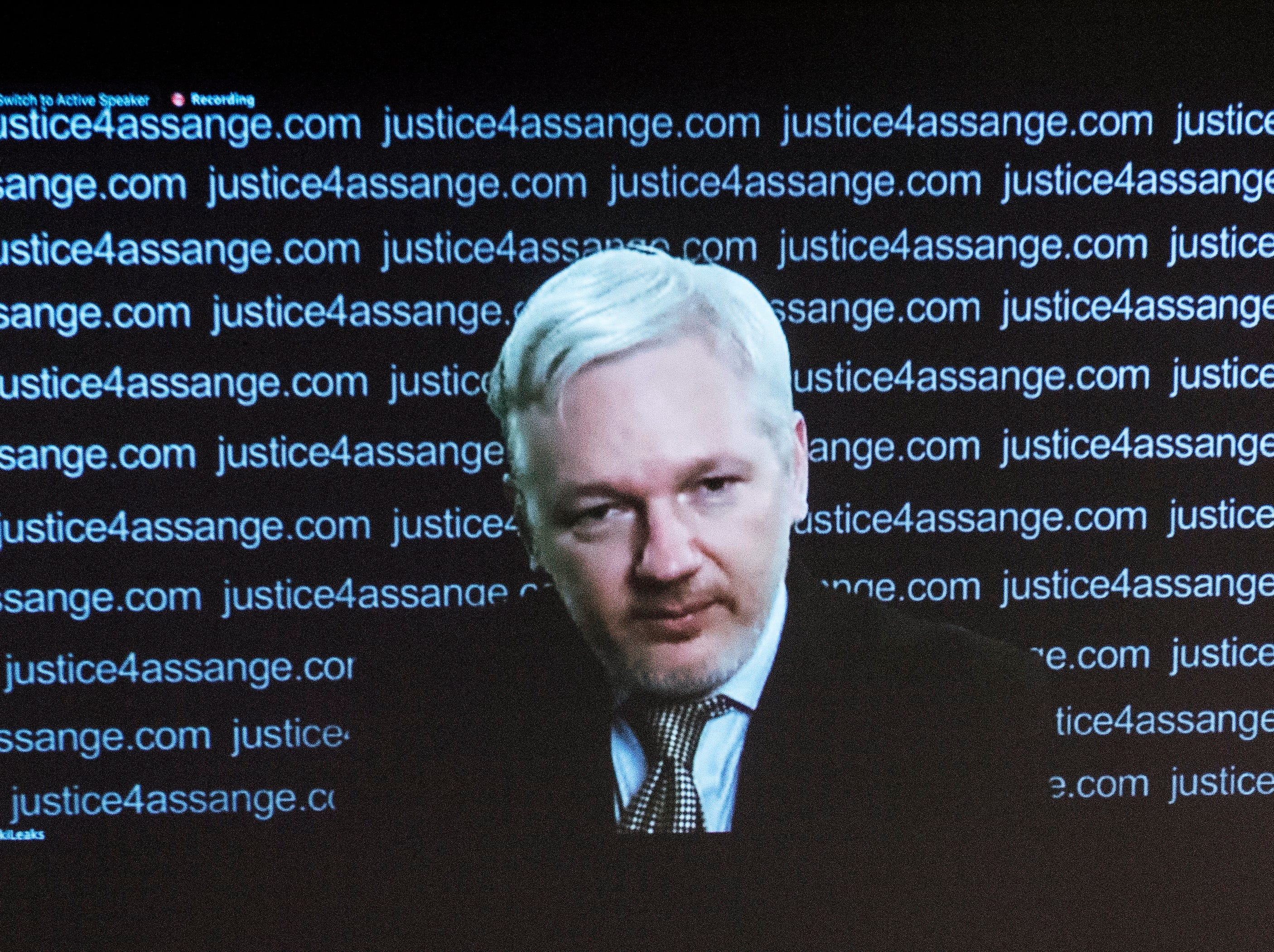 Julian Assange addresses a press conference at the Frontline Club via video link from the Ecuadorian embassy in 2016.
