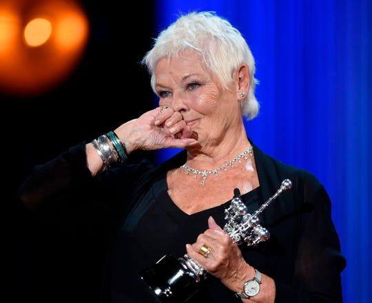 Judi Dench receives an award at the San Sebastian Film Festival in Spain.