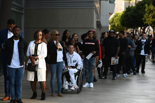 People arrive to attend the Celebration of Life memorial service for Nipsey Hussle in Los Angeles.