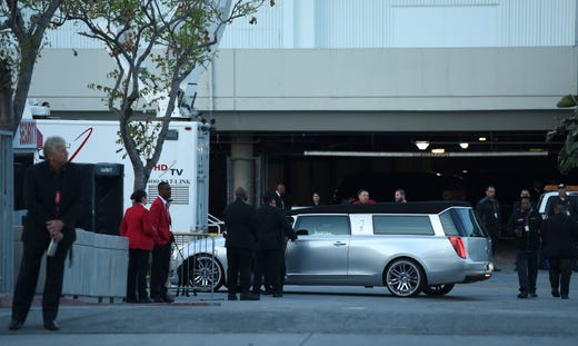 A silver hearse at the Celebration of Life memorial service for late rapper Nipsey Hussle.