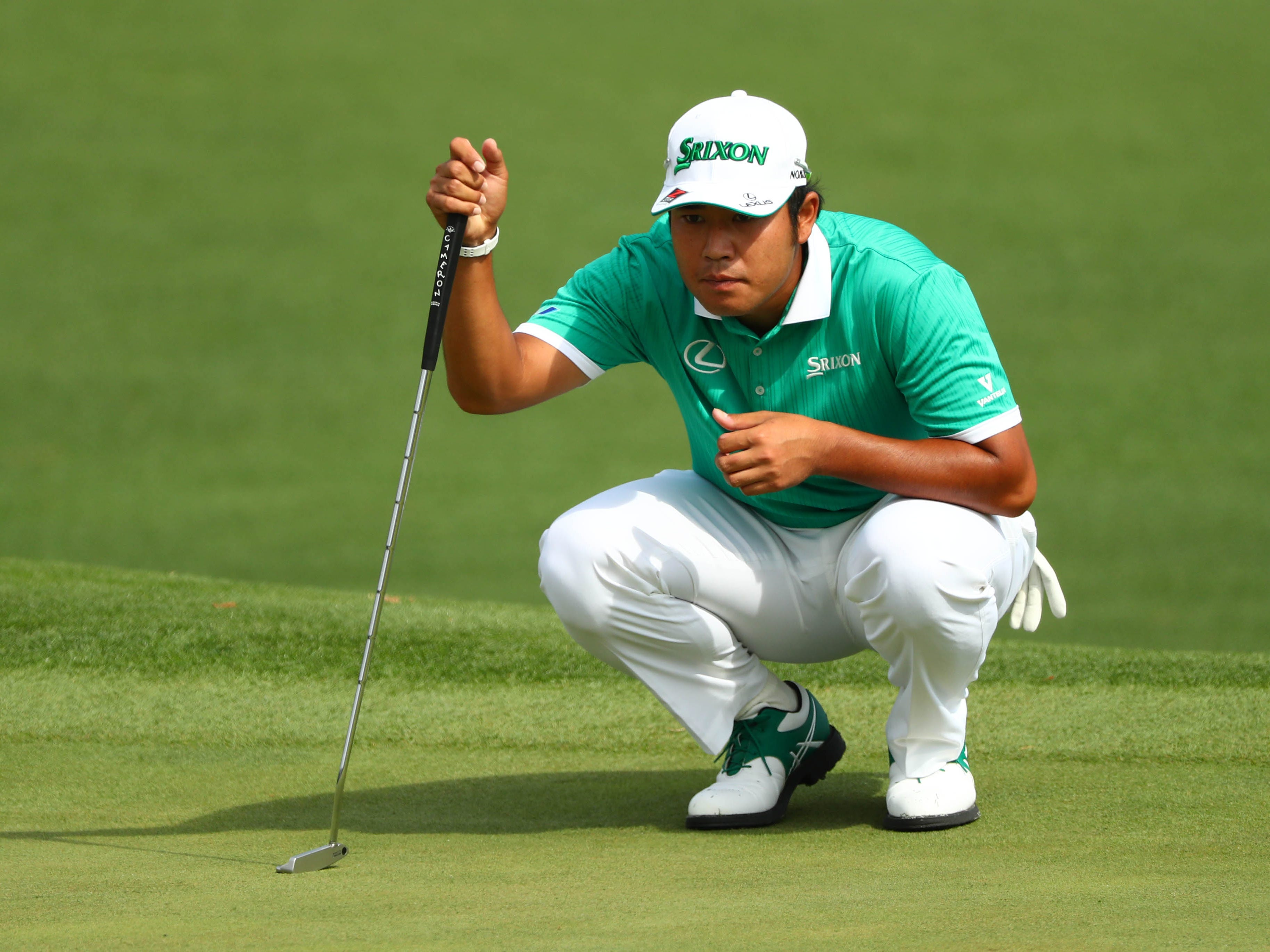 Hideki Matsuyama lines up a putt during the first round.