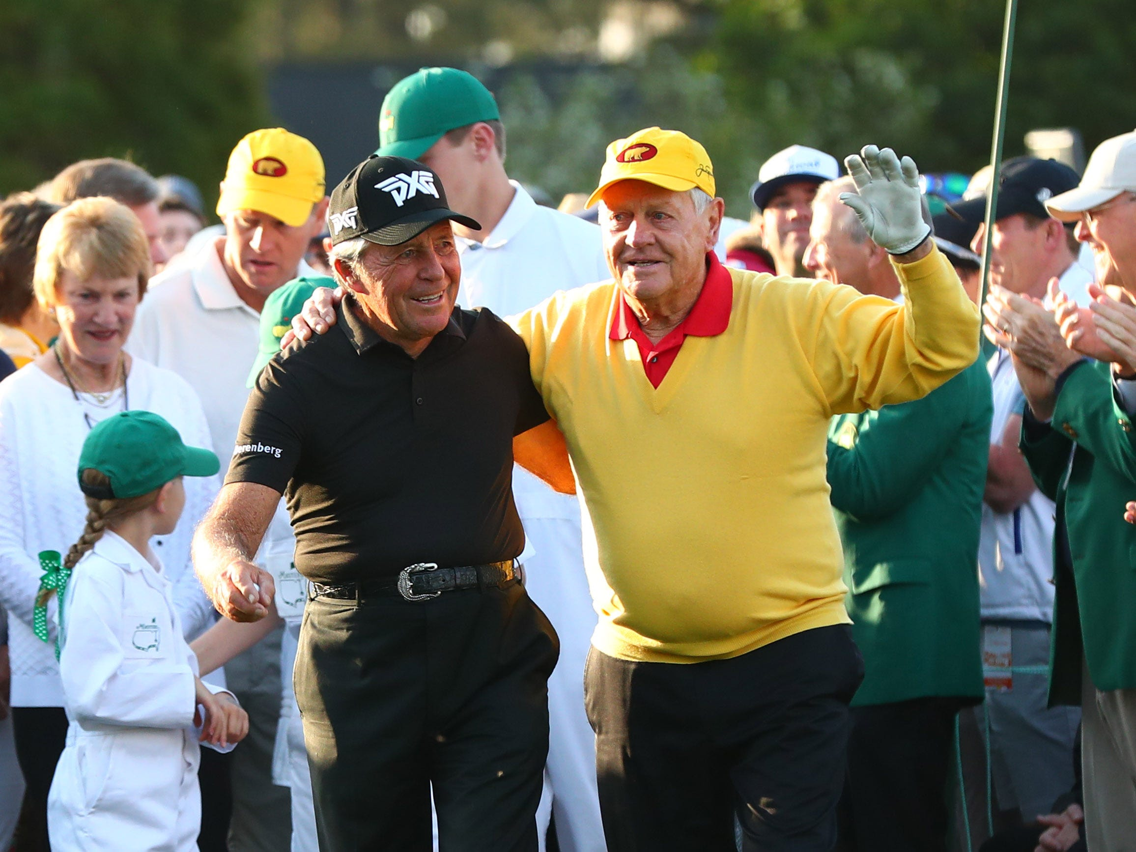 Honorary starters Gary Player and Jack Nicklaus walk to the first tee at the Masters.