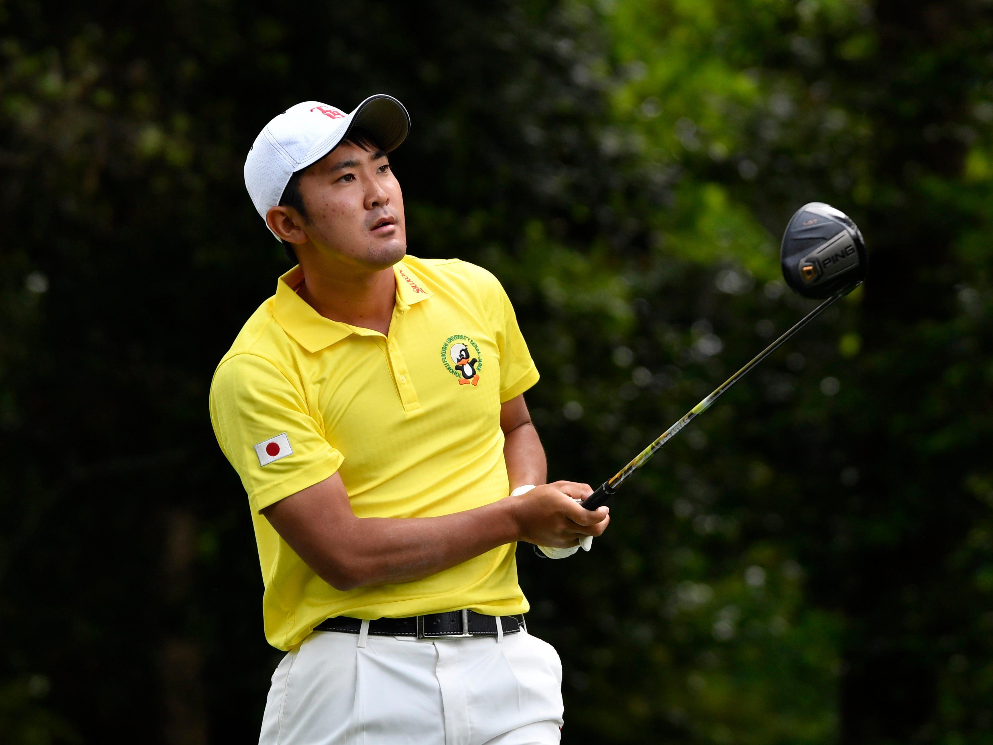 Takumi Kanaya hits his tee shot on the second hole at the Masters.
