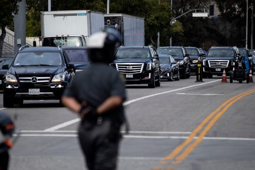 Vehicles taking part in the procession arrive for the Celebration of Life memorial service for late rapper Nipsey Hussle.