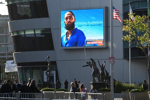 People arrive to attend the Celebration of Life memorial service for rapper recording artist and social activist Nipsey Hussle, on April 11, 2019 at the Staples Center in Los Angeles. Hussle, born Ermias Ashgedom, was fatally shot outside his Marathon Clothing store in South Los Angeles on March 31, 2019.