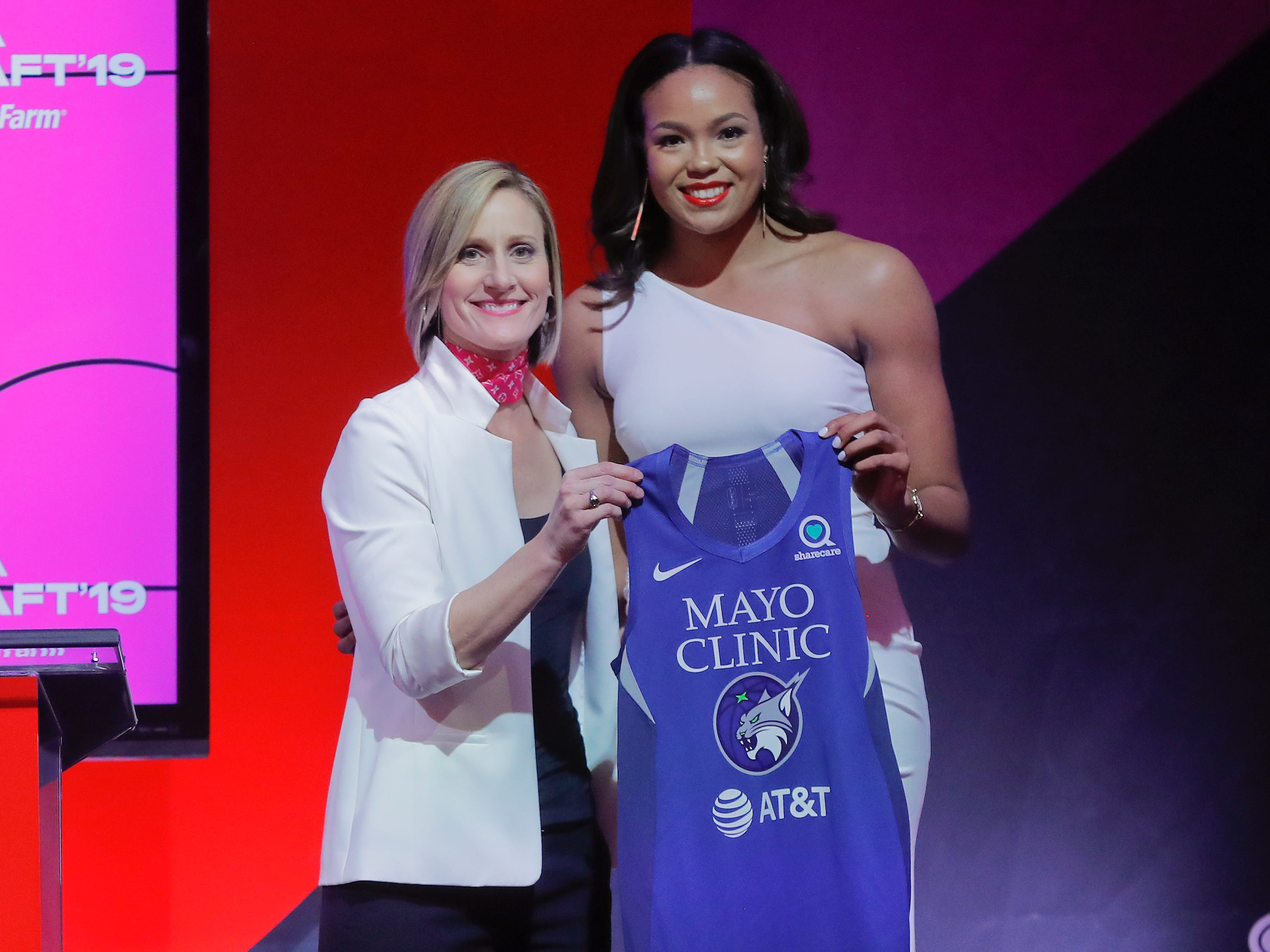 Connecticut's Napheesa Collier poses for a photo with WNBA COO Christy Hedgpeth after being selected by the Minnesota Lynx as the sixth overall pick in the WNBA draft.