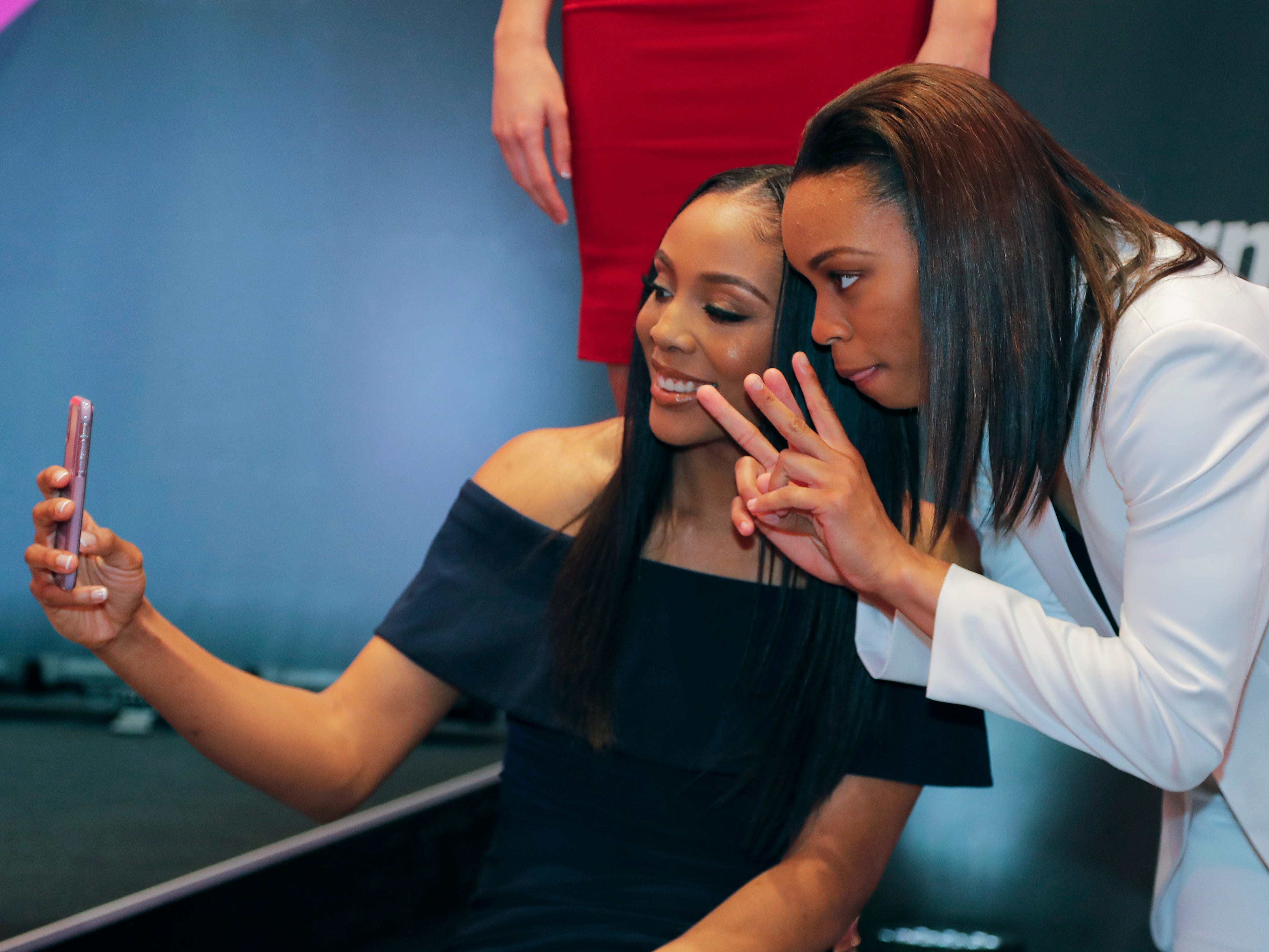 Kristine Anigwe (left) and Asia Durr take a selfie before the WNBA draft.