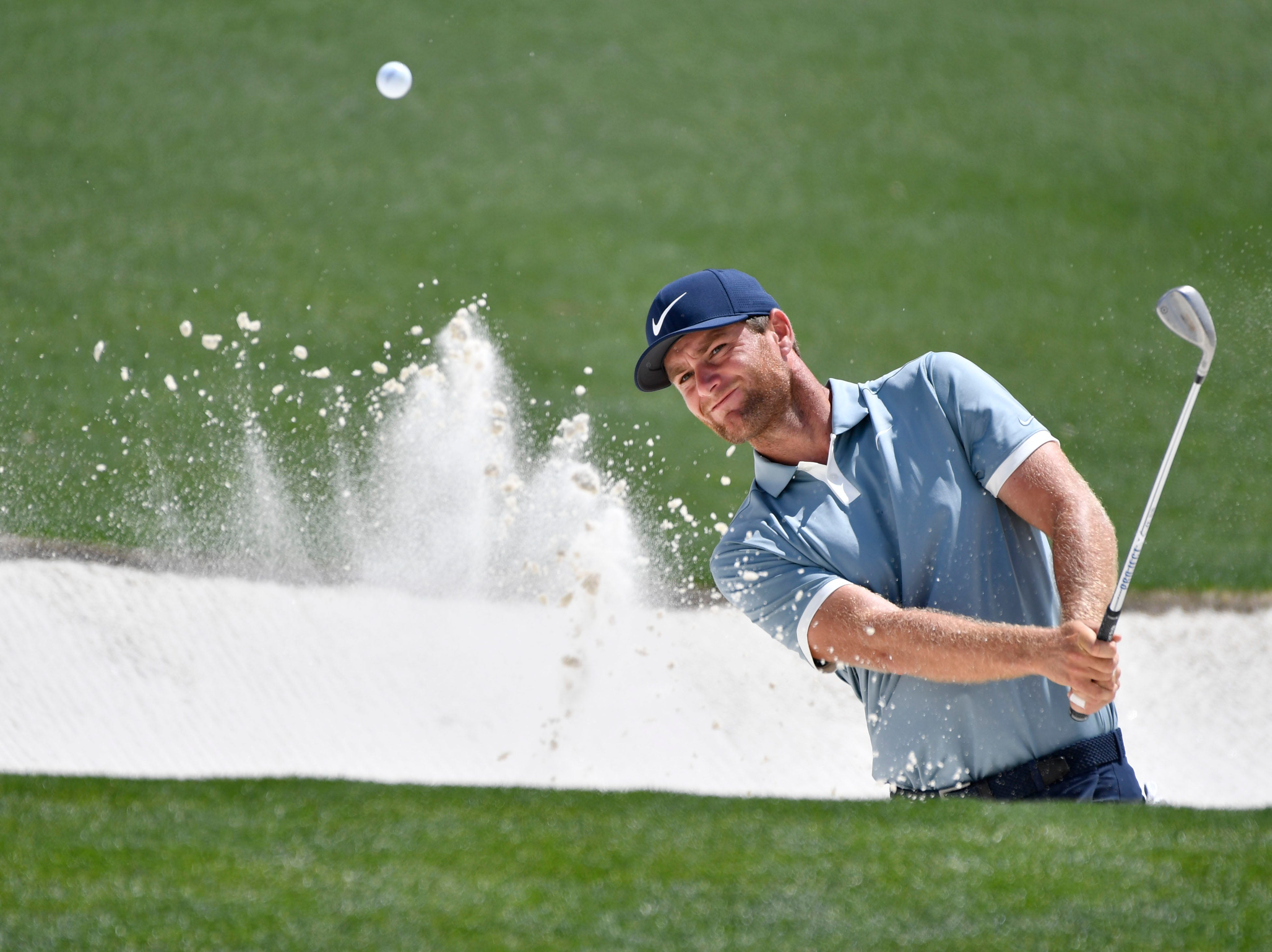 Lucas Bjerregaard hits out of a bunker on the 18th hole during the first round of the Masters.