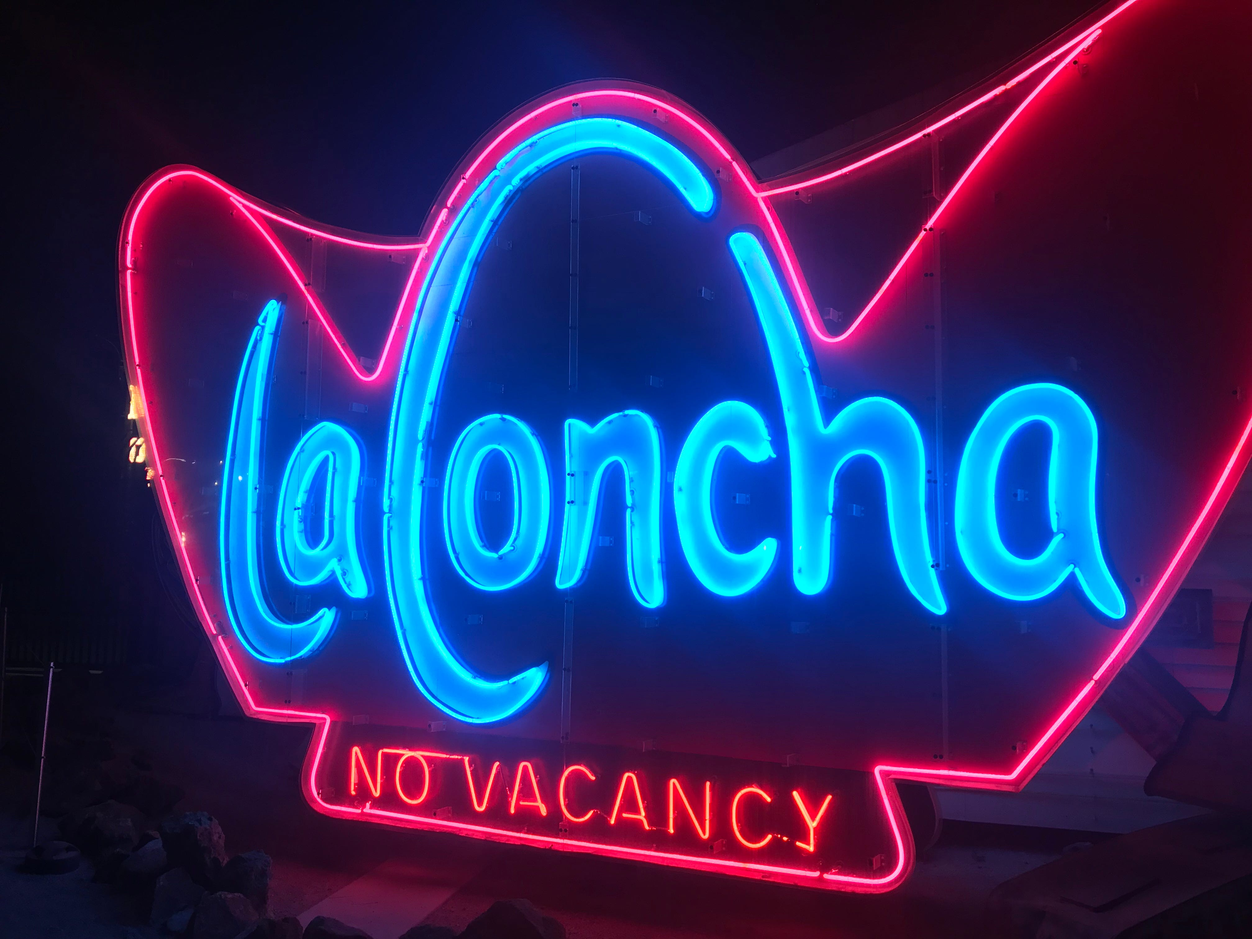 La Concha Motel sign at night at the Neon Museum. The hotel's lobby is now the lobby for the museum.
