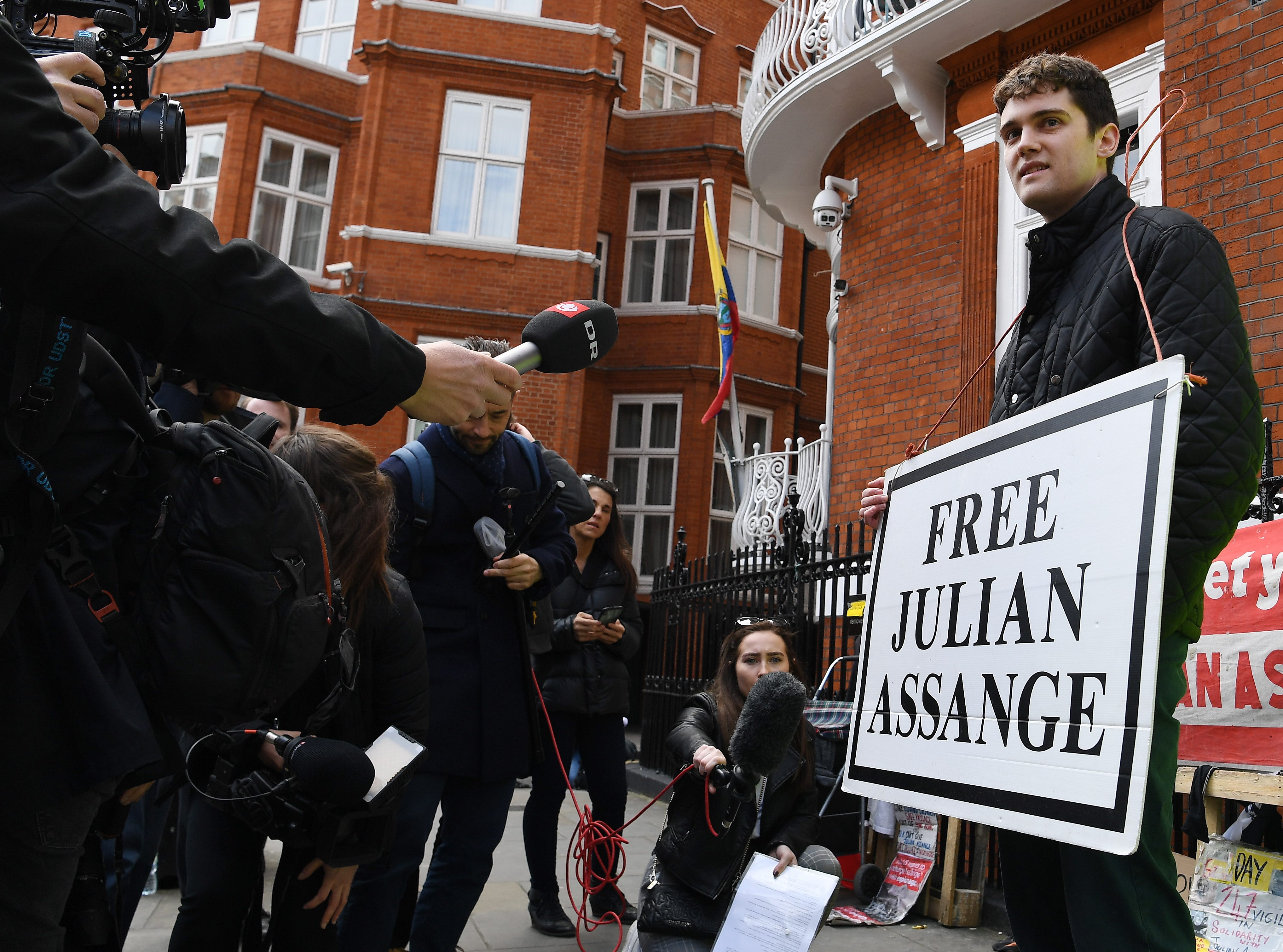 A Julian Assange supporter protests outside the Ecuadorian Embassy in London, on April 11, 2019.