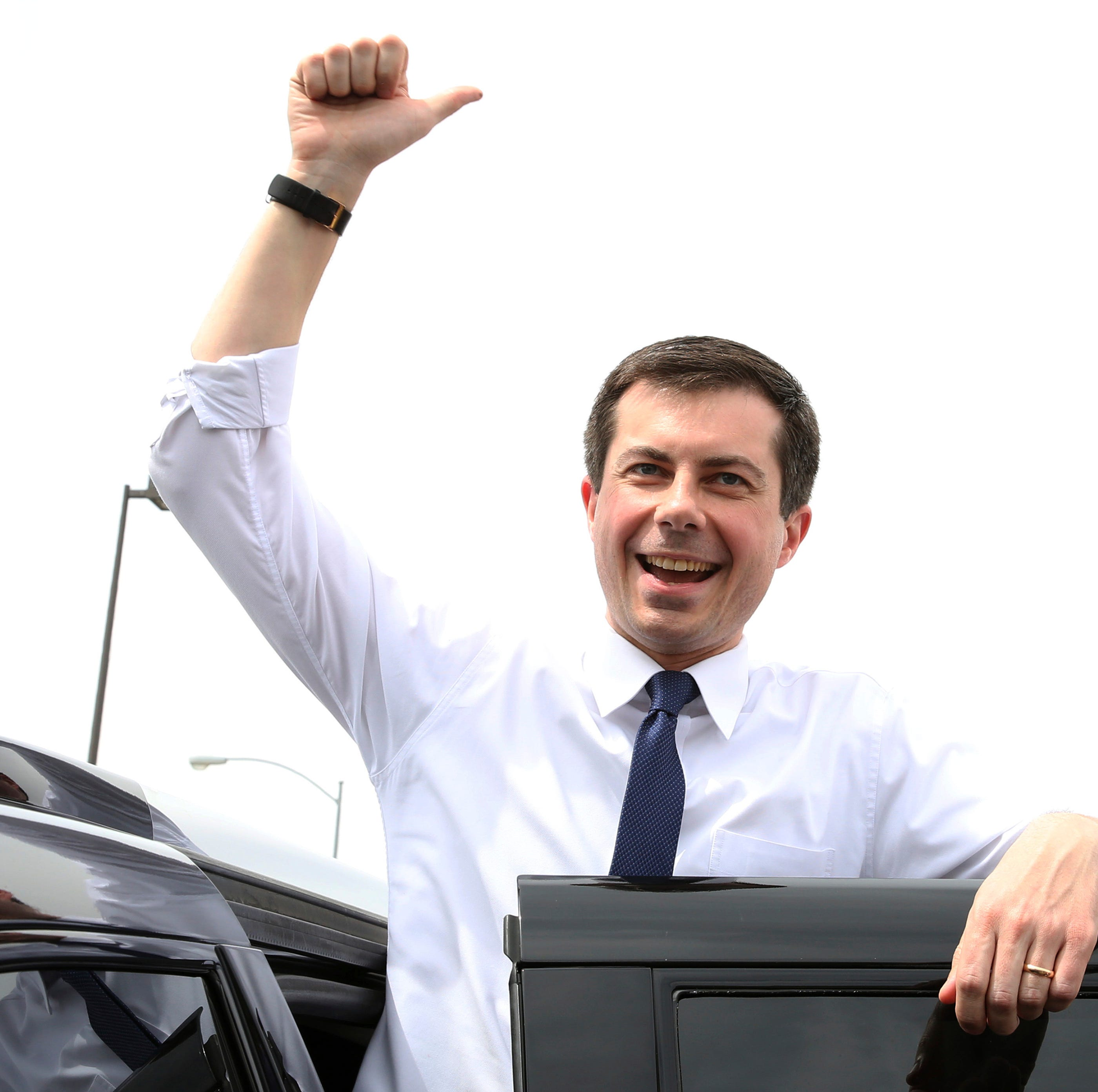 South Bend, Ind. Mayor Pete Buttigieg flashes a thumbs-up as he prepares to depart after speaking at a meet and greet event at MadHouse Coffee on Monday, April 8, 2019, in Las Vegas.