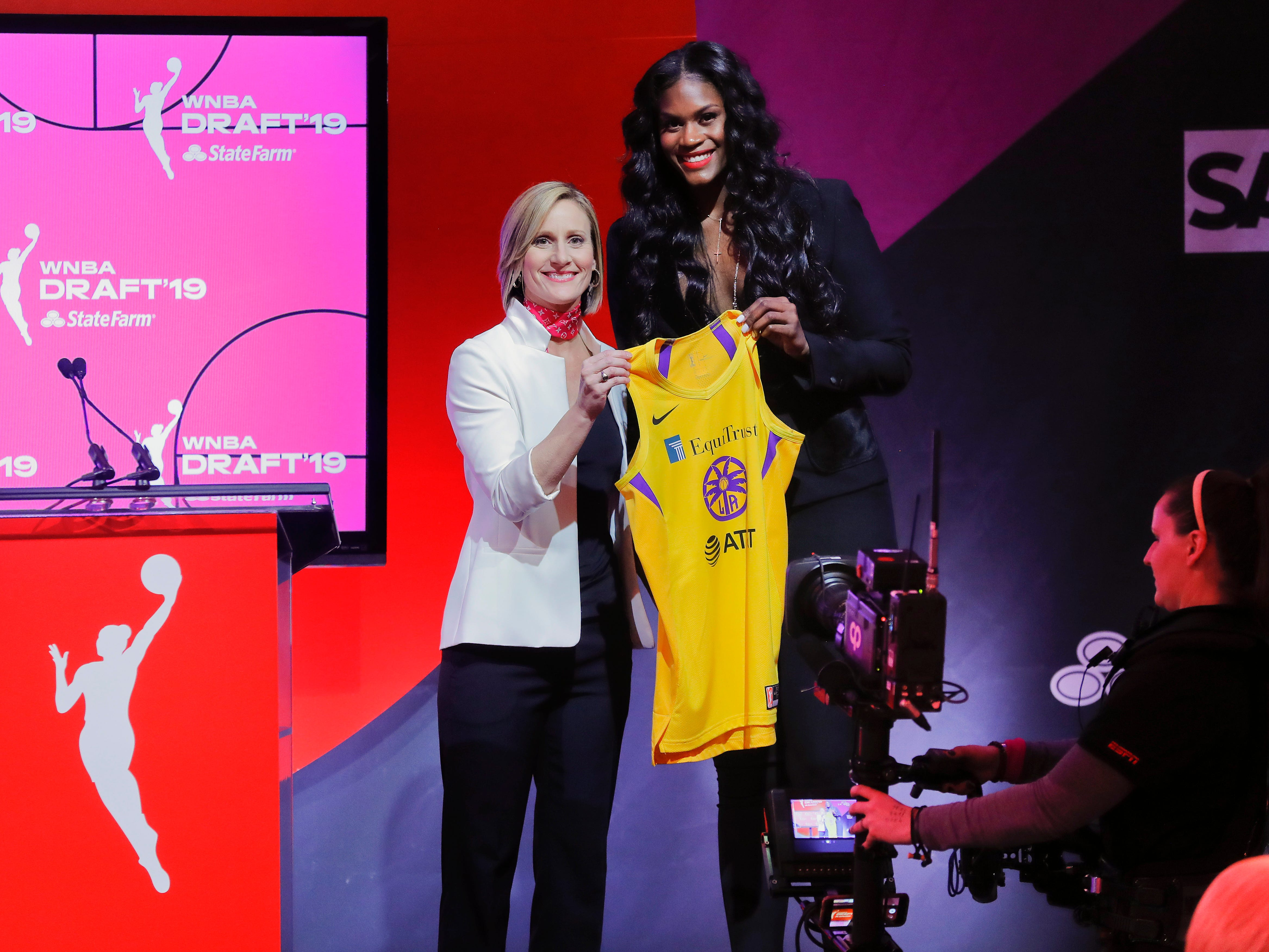 Baylor's Kalani Brown poses for a photo with WNBA COO Christy Hedgpeth after being selected by the Los Angeles Sparks as the seventh overall pick in the WNBA draft.