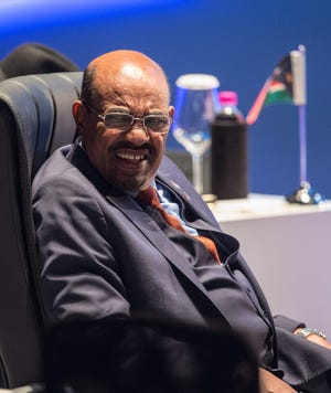 In this file photo taken on Oct. 29, 2015 Sudan's President Omar al-Bashir reacts after addressing the India-Africa Forum Summit in New Delhi.