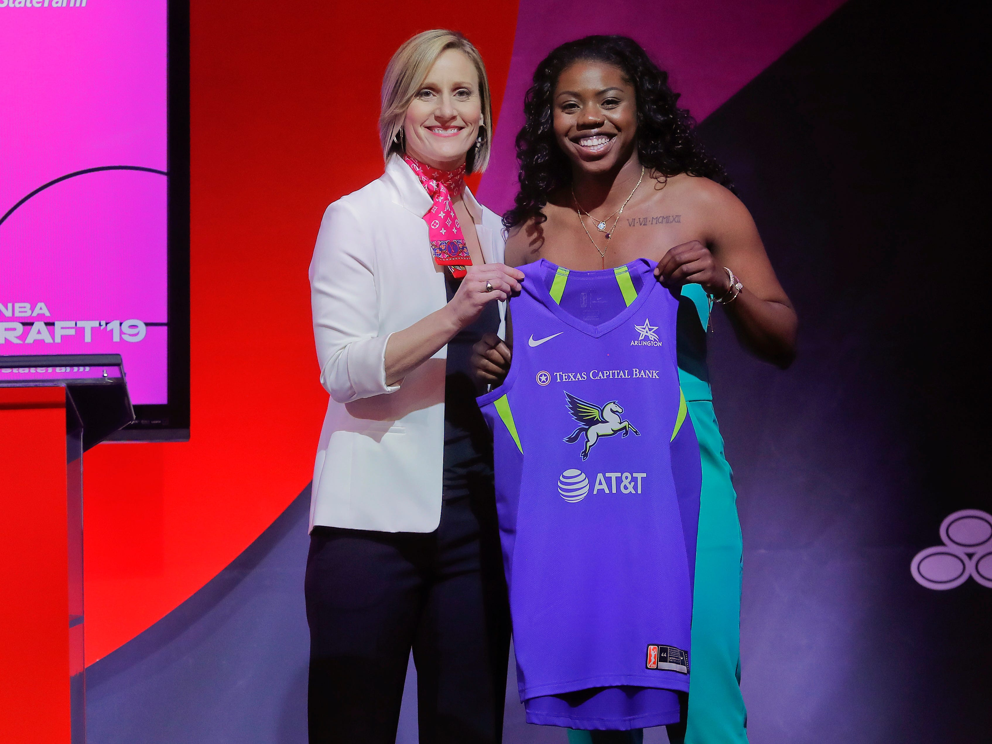Notre Dame's Arike Ogunbowale poses for a photo with WNBA COO Christy Hedgpeth after being selected by the Dallas Wings as the fifth overall pick in the WNBA draft.