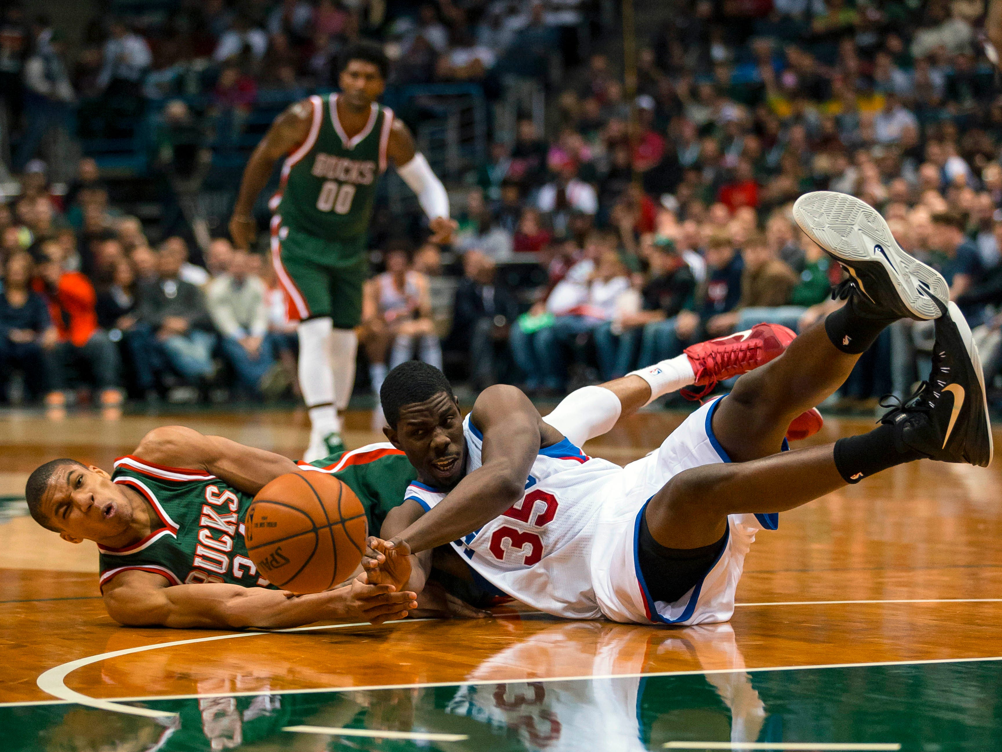 Antetokounmpo battles for a loose ball during a 2014 game against Philadelphia.