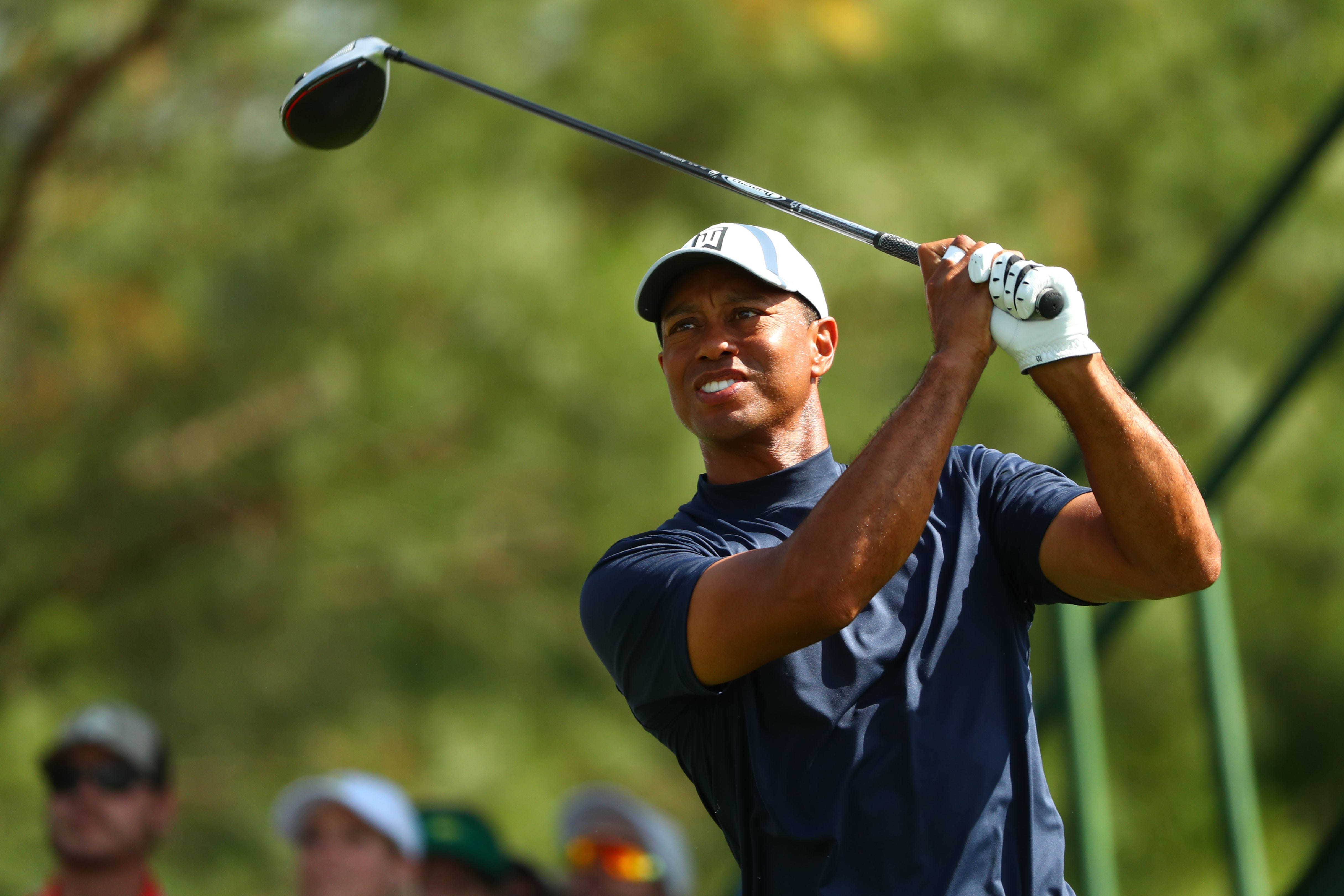 Tiger Woods, hitting his tee shot on the 18th hole, posted a 2-under 70 Thursday in the first round of the Masters.