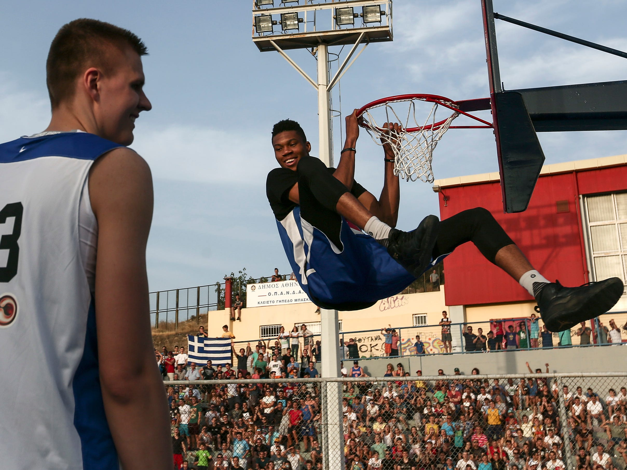 Antetokounmpo joins fellow budding star Kristaps Porzingis for a charity streetball event in his native Athens in 2016.