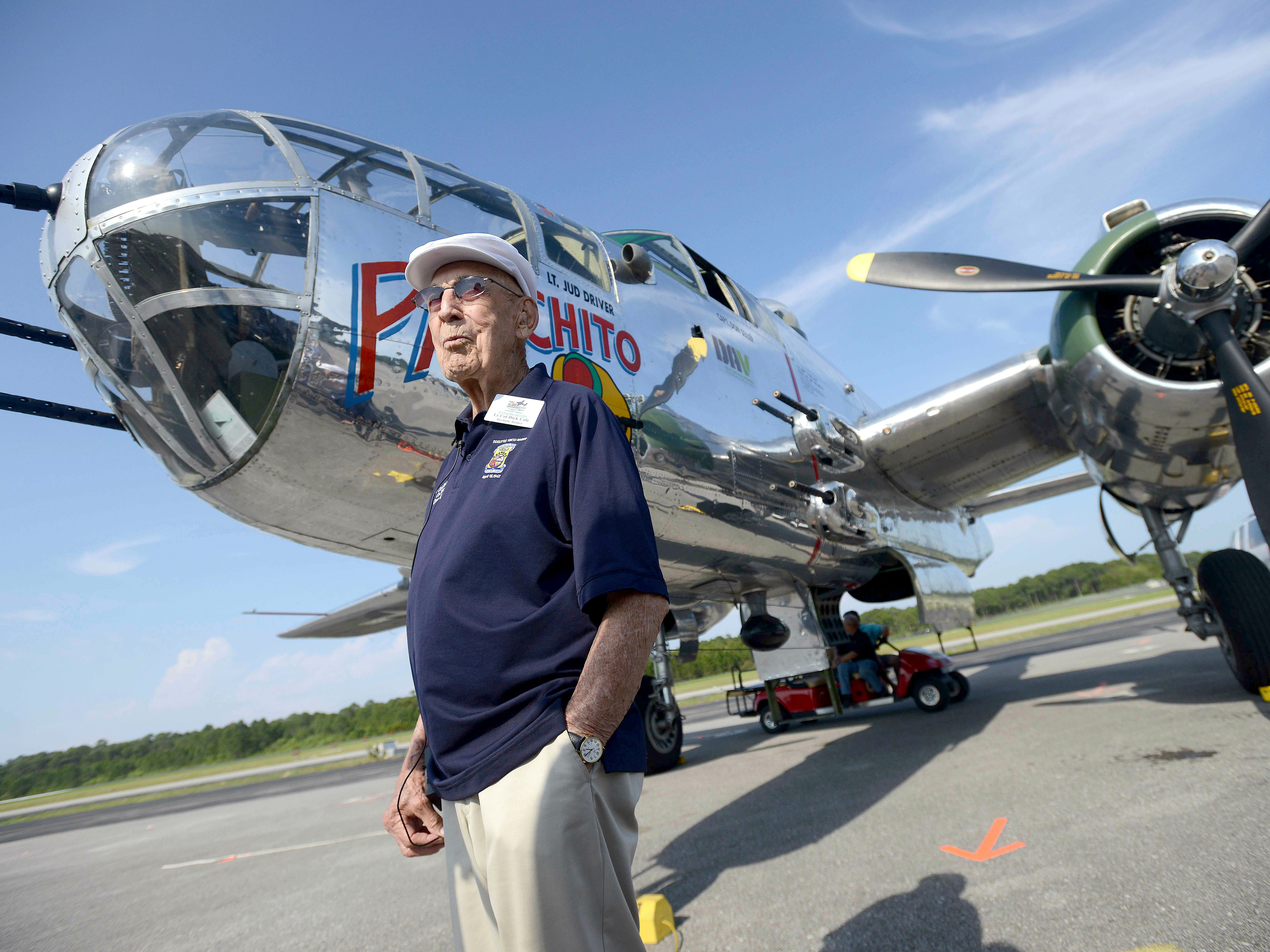 """In this April 16, 2013 file photo, Doolittle Raider Lt. Col. Dick Cole, stands in front of a B-25 at the Destin Airport in Destin, Fla. before a flight as part of the Doolittle Raider 71st Anniversary Reunion. Retired Lt. Col. Richard """"Dick"""" Cole, the last of the 80 Doolittle Tokyo Raiders who carried out the daring U.S. attack on Japan during World War II, has died at a military hospital in Texas. He was 103. A spokesman says Cole died Tuesday, April 9, 2019, at Brooke Army Medical Center in San Antonio, Texas."""