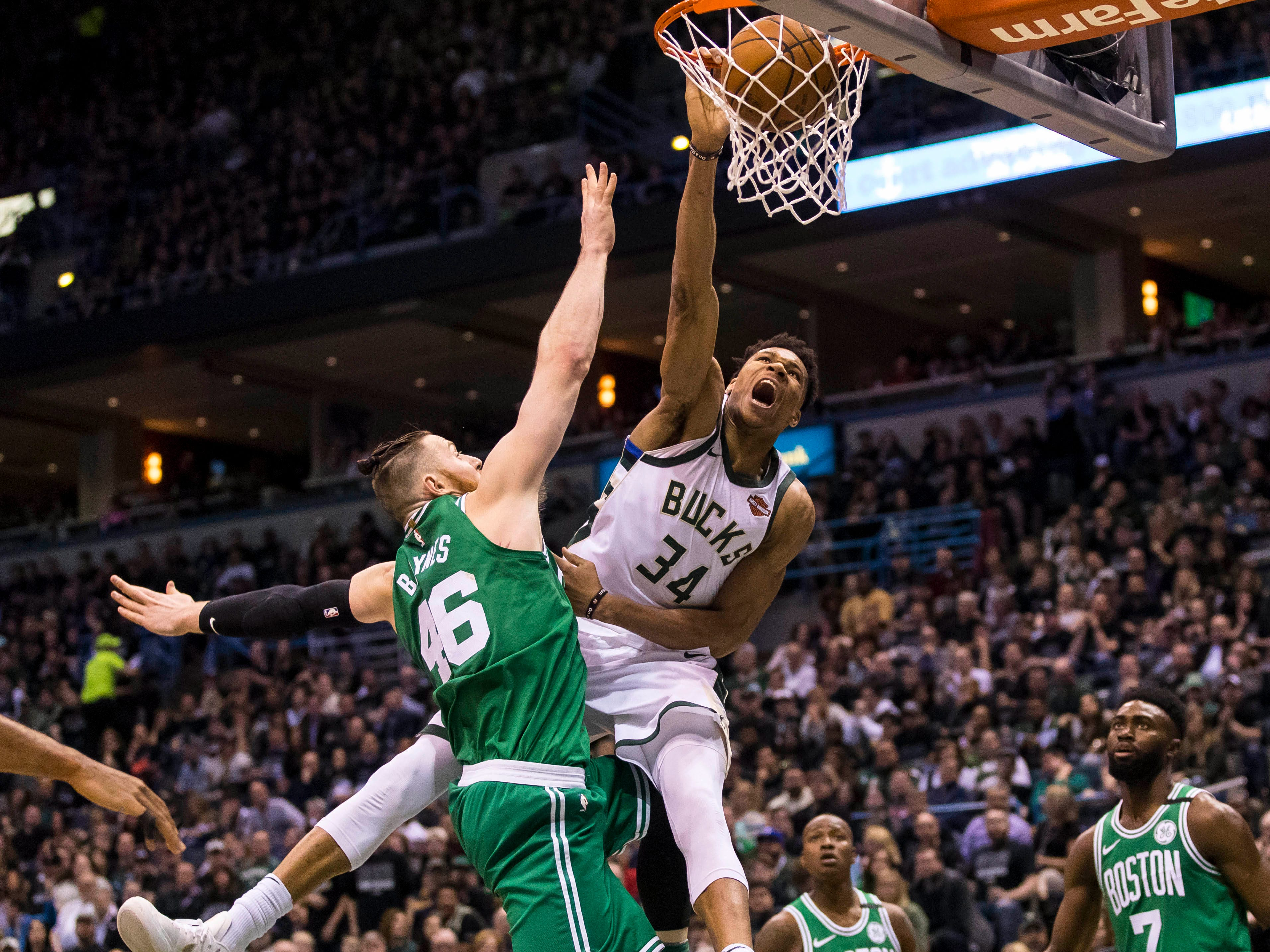 Antetokounmpo puts Boston defender Aron Baynes on a poster with a ferocious one-handed slam during the 2018 playoffs.