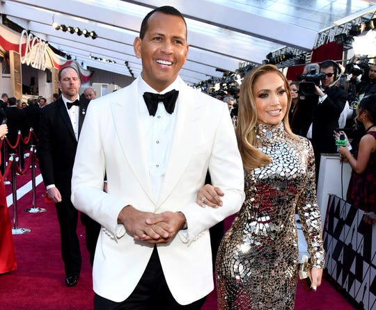 Alex Rodriguez, left, and Jennifer Lopez arrive at the Oscars in Los Angeles on Feb. 24, 2019.