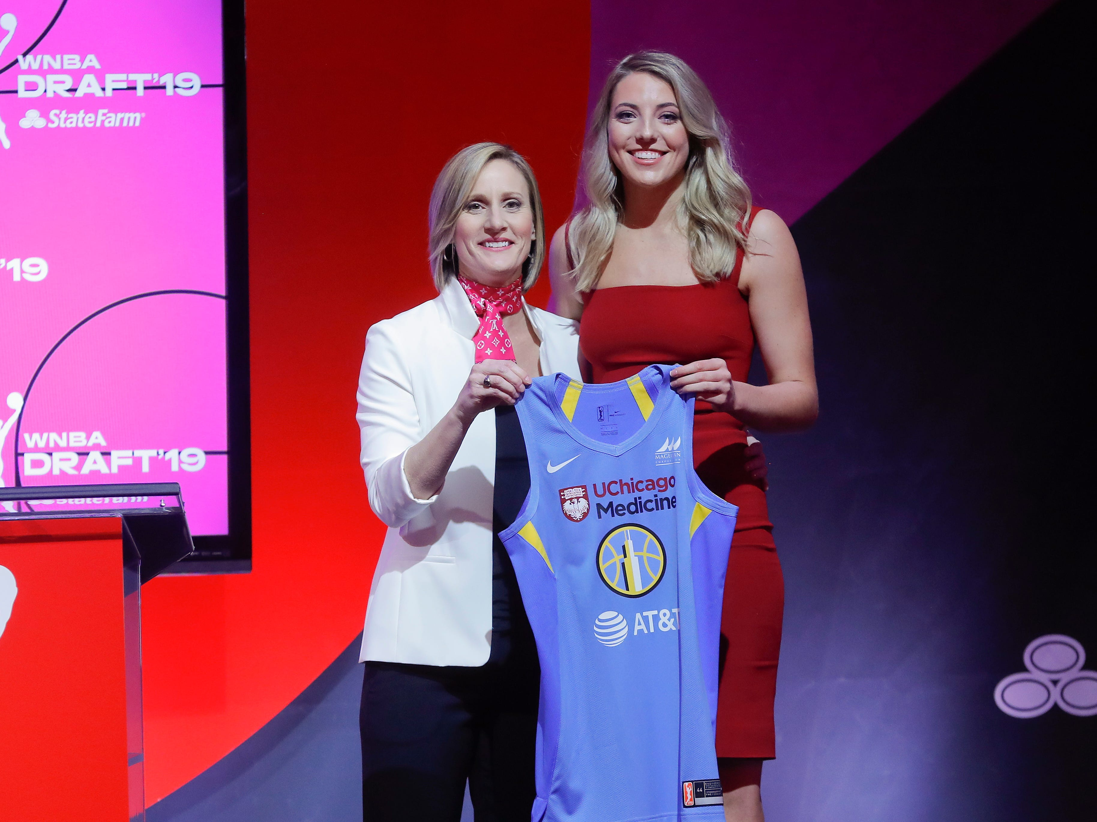 Connecticut's Katie Lou Samuelson poses for a photo with WNBA COO Christy Hedgpeth after being selected by the Chicago sky as the fourth overall pick in the WNBA draft.