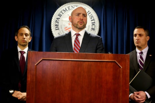 US Attorney Andrew E. Lelling (C) speaks during a press conference with Eric Rosen of the US Attorney's Office (L) and FBI Special Agent in Charge Joseph R. Bonavolonta (R) at the federal courthouse in Boston, on March 12, 2019.