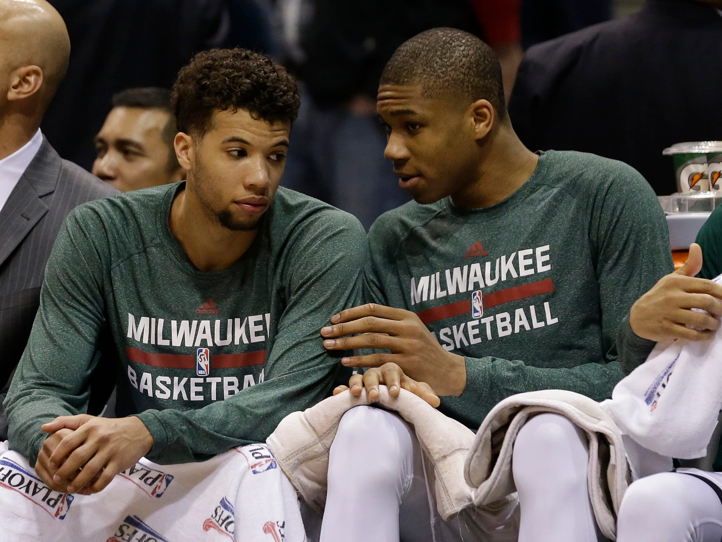 Michael Carter-Williams and Antetokounmpo talk on the bench during the 2015 playoffs.