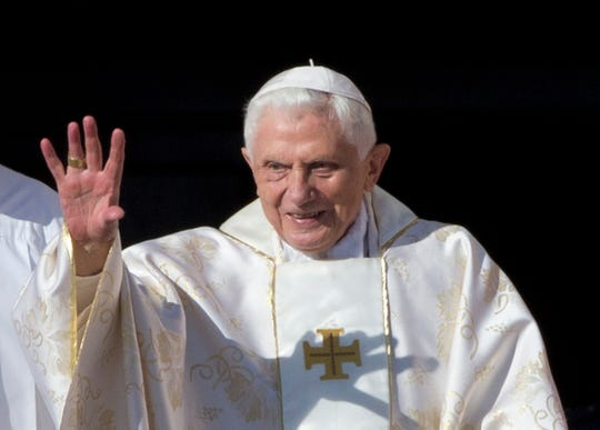 Pope Emeritus Benedict XVI arrives in St. Peter's Square at the Vatican to attend the beatification ceremony of Pope Paul VI on Oct. 19, 2014.