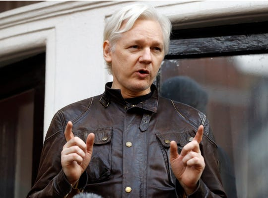 In this May 19, 2017, file photo, WikiLeaks founder Julian Assange gestures to supporters outside the Ecuadorian embassy in London.