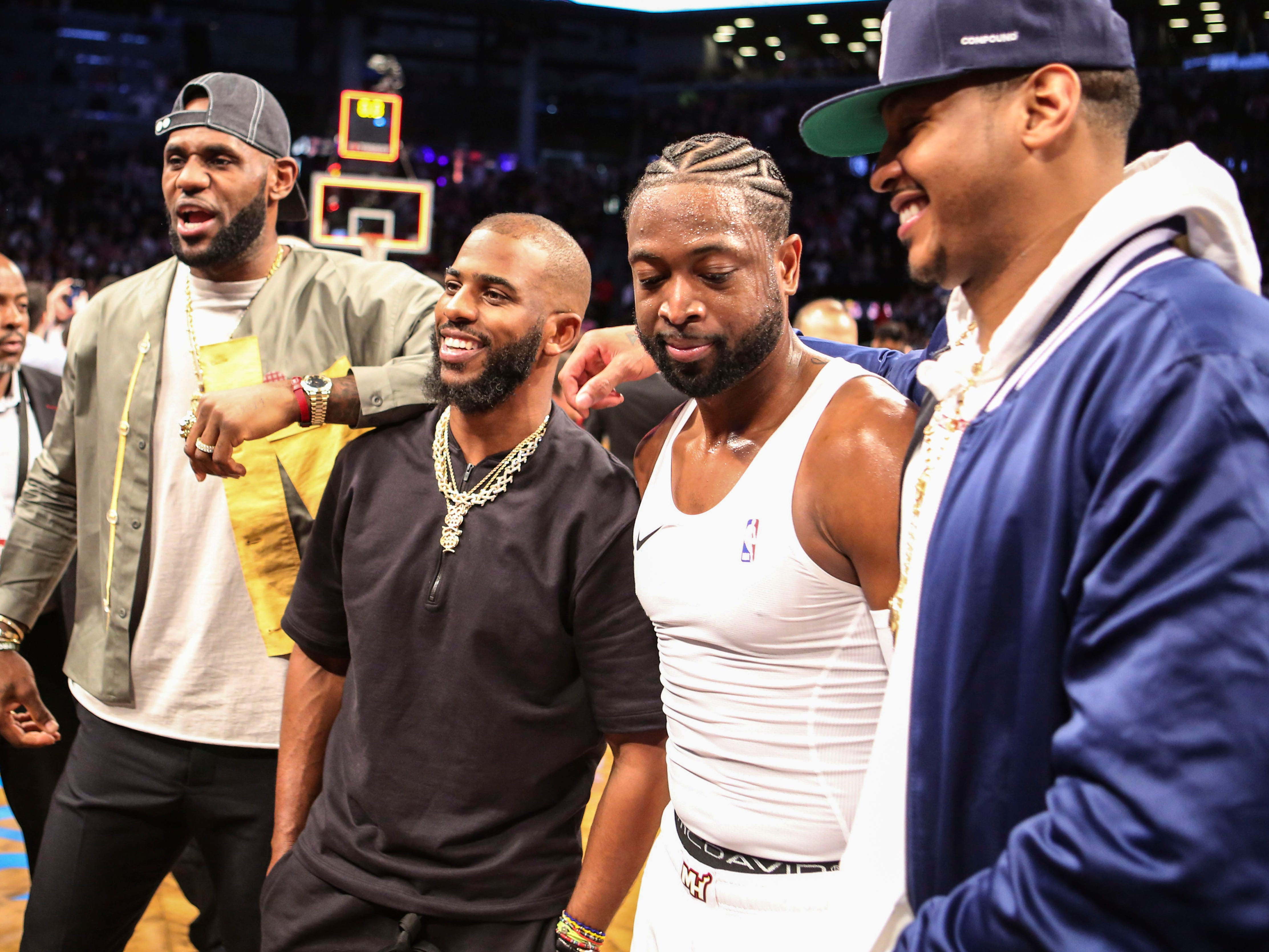 From left, LeBron James, Chris Paul, Dwyane Wade and Carmelo Anthony pose after Wade's final career game in Brooklyn. The retiring Wade went out in style with a triple-double.