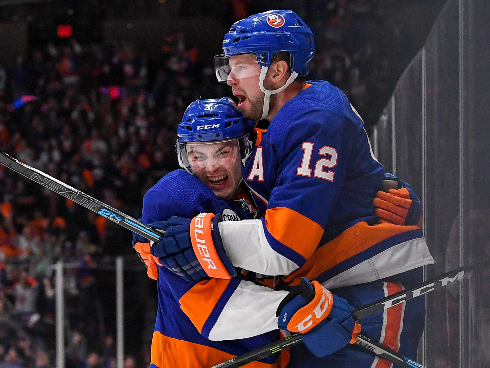 First round: New York Islanders right wing Josh Bailey, right, celebrates with Islanders defenseman Adam Pelech  after scoring in overtime against the Pittsburgh Penguins.